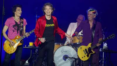 """Watch Mick Jagger get """"all emotional"""" speaking about Charlie Watts onstage"""